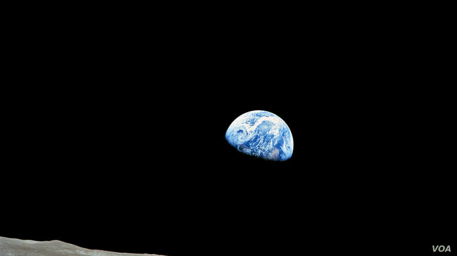 The distant blue Earth is seen above the Moon's limb, in this handout picture taken by the Apollo 8 crew forty-five years ago, on December 24, 1968, courtesy of NASA. Frank Borman, James Lovell, and William Anders were launched atop a Saturn V rocket