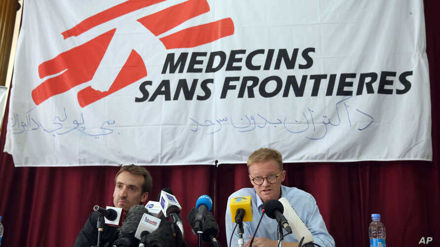 The general director of medical charity, Medecins Sans Frontieres (MSF), Christopher Stokes, right, talks as MSF's Country Representative for Afghanistan, Guilhem Molinie, left, listens, during a press conference at their office, in Kabul, Afghanista