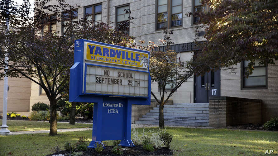 FILE - A sign is seen in front of the Yardville Elementary School in Hamilton Township, N.J., where a 4-year-old student died Thursday.