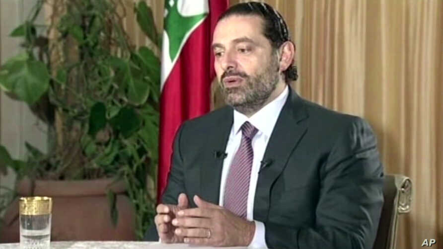 "Lebanon's Prime Minister Saad Hariri gives a live TV interview in Riyadh, Saudi Arabia, Sunday Nov. 12, 2017,  saying he will return to his country ""within days""."