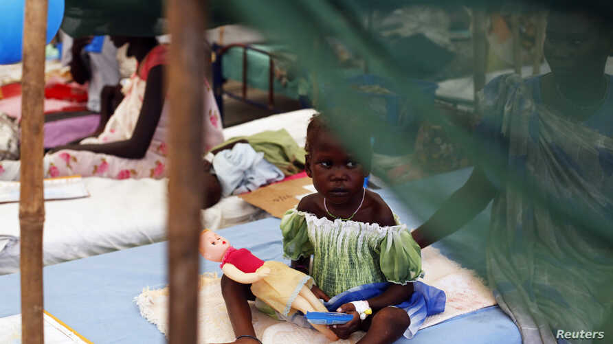 A malnourished girl plays at a hospital in a U.N. refugee camp in Malakal, July 24, 2014.