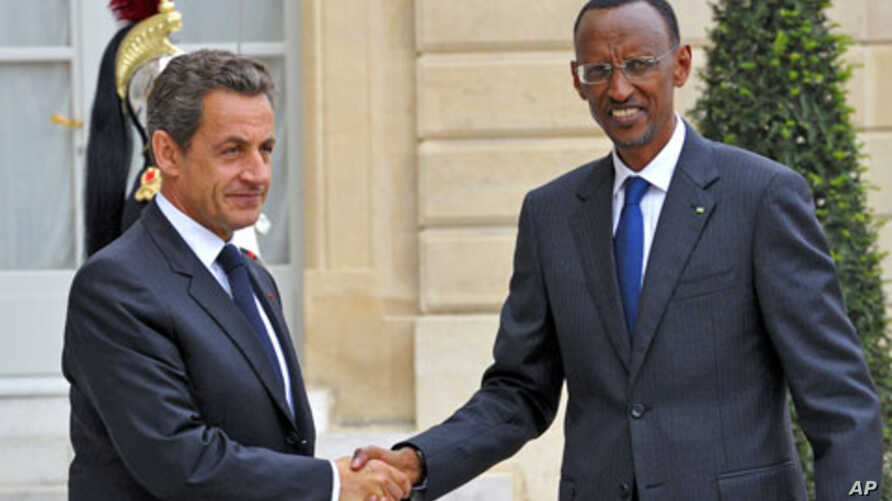 France's President Nicolas Sarkozy (L) welcomes his Rwandan counterpart Paul Kagame as he arrives at the Elysee palace in Paris, September 12, 2011.