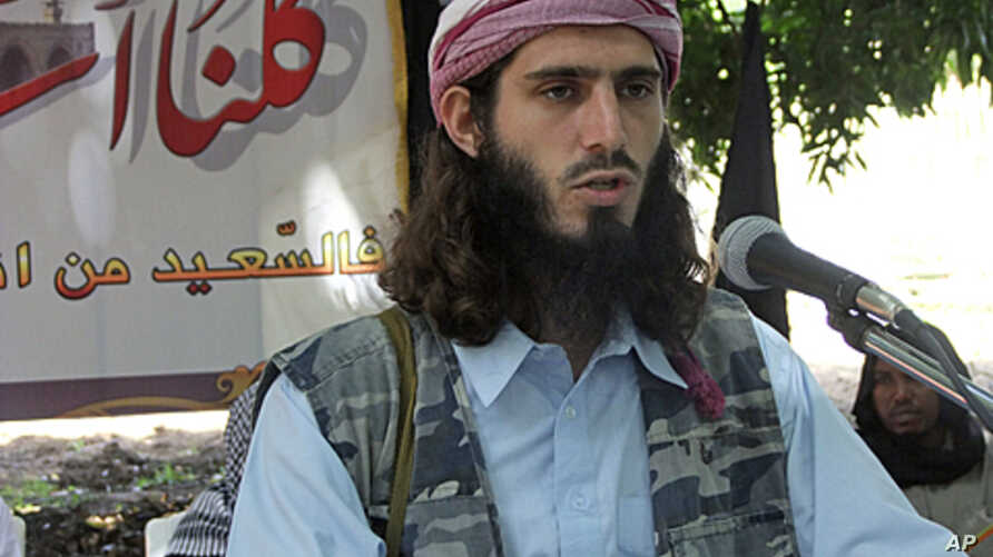 American born Islamist militant fighter Omar Hamammi, known as Abu Mansur Al-Amriki, adresses a press conference  at a farm in southern Mogadishu's Afgoye district, Somalia, May 11, 2011.