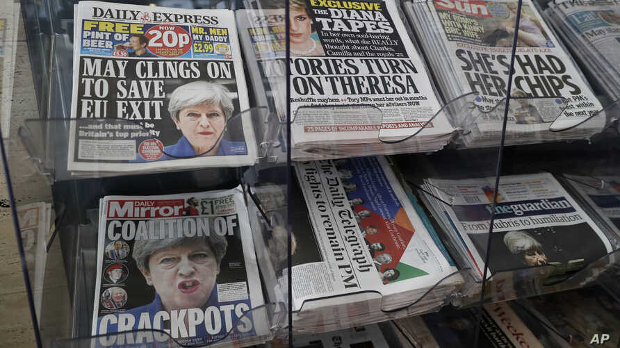Newspapers fronted with photos of British Prime Minister Theresa May and others are displayed at a shop in Westminster in London, June 10, 2017.