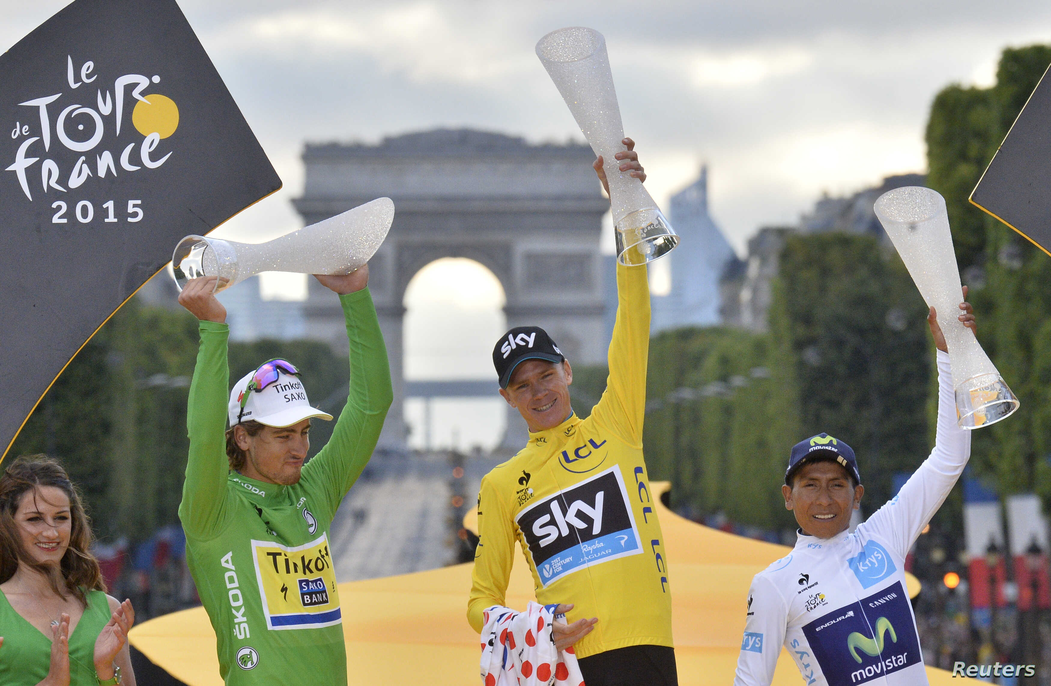 Chris Froome, center, celebrates his overall victory on the podium with Peter Sagan of Slovakia, left, holder of the best sprinter's green jersey, and Nairo Quintana of Colombia, holder of the best young rider's white jersey, after the final stage of