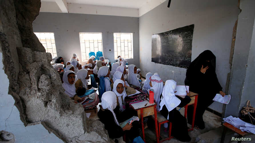 Girls attend a class at their school damaged by a recent Saudi-led air strike, in the Red Sea port city of Hodeidah, Yemen, Oct. 24, 2017.