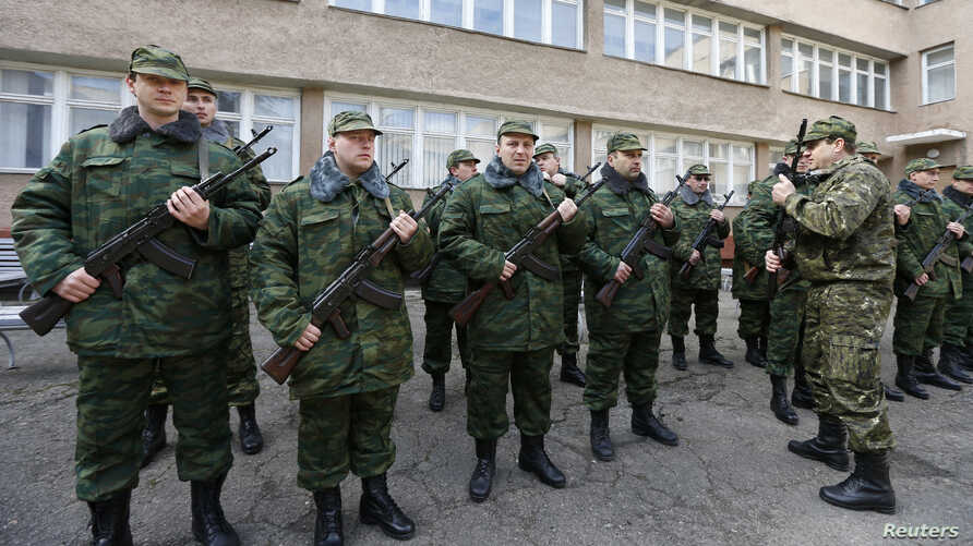 Members of a pro-Russian self-defense unit stand in formation as they ready to swear an oath to the pro-Russia Crimea regional government in Simferopol, March 13, 2014.