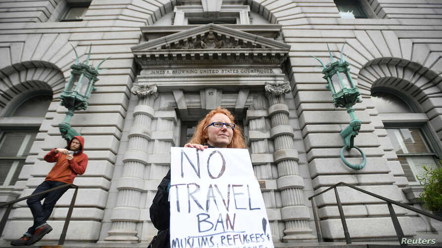 Beth Kohn protests against U.S. President Donald Trump's executive order outside the 9th U.S. Circuit Court of Appeals courthouse in San Francisco, California, Feb. 7, 2017.
