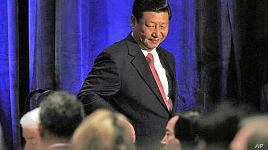 China's Vice President Xi Jinping leaves the stage after speaking to the US-China Business Council in Washington, February 15, 2012.