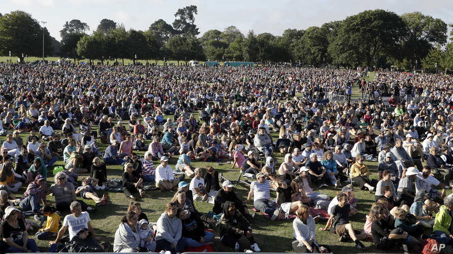 People gather for a vigil in Hagley Park following the March 15 mass shooting in Christchurch, New Zealand, March 24, 2019.