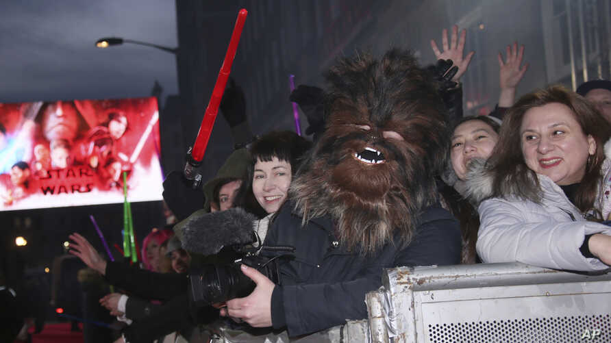 Fans gather ahead of the premiere of the film 'Star Wars: The Last Jedi' in London, Dec. 12, 2017.