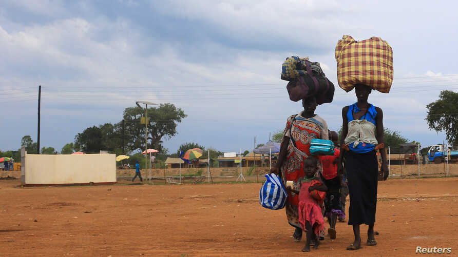 South Sudan refugees family arrives at the U.N. High Commissioner for Refugees-managed refugee reception point at Elegu, in Amuru district of the northern region near the South Sudan-Uganda border, August 20, 2016.