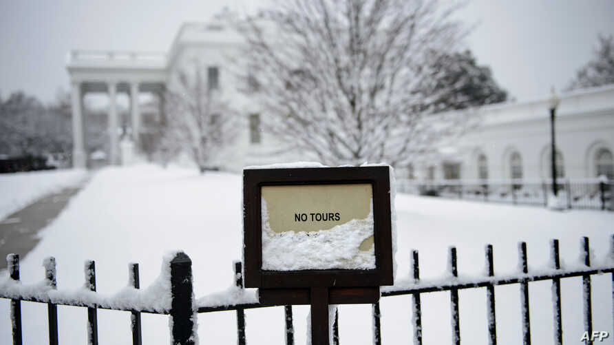 The White House is seen during a winter storm on the 23rd day of the U.S. government shutdown, Jan. 13, 2019, in Washington.