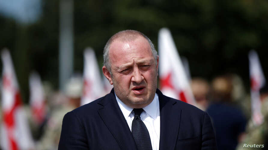 FILE - Georgia's President Giorgi Margvelashvili speaks to media after a ceremony at the memorial cemetery of the Georgian soldiers killed during the war with Russia over the breakaway region of South Ossetia in 2008 in Tbilisi, Georgia, Aug. 8, 2017