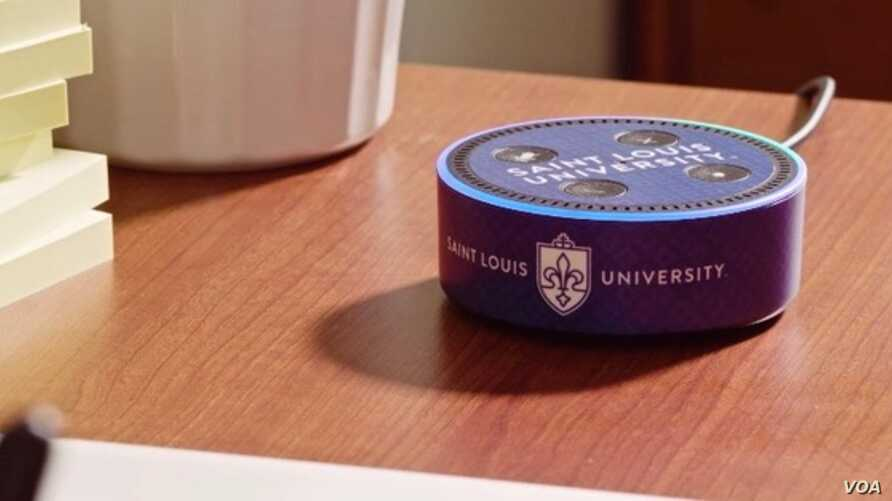 The Alexa Echo Dot devices include the official Saint Louis University logo and are equipped with specific skills to provide information on local events and campus life. (Screengrab for Saint Louis University Video)