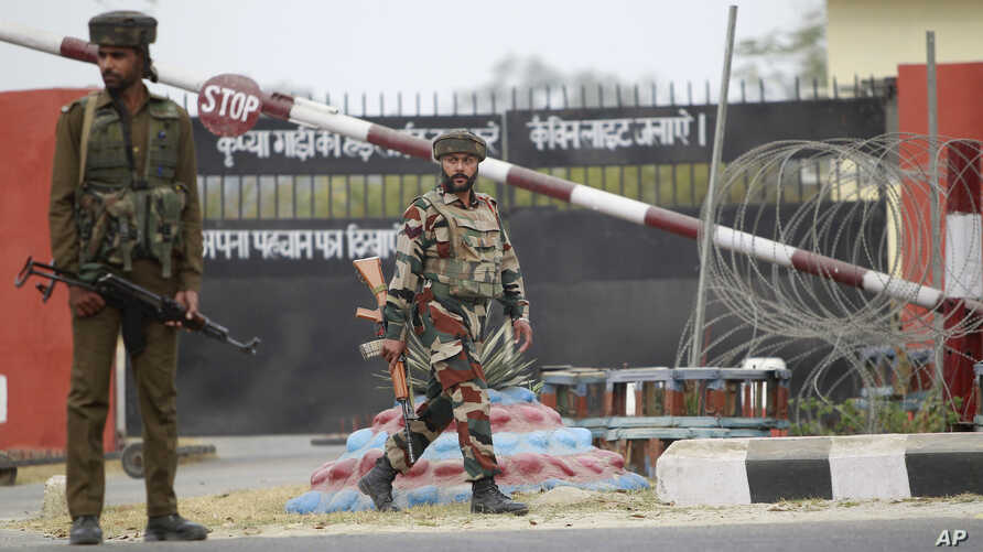 Indian soldiers are seen outside an army camp at Nagrota, in the outskirts of Jammu, Nov. 29, 2016.