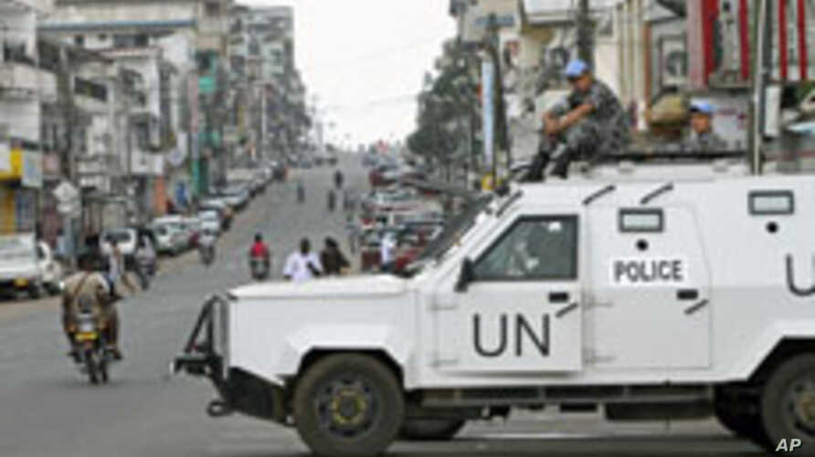 United Nations [UN] peacekeepers patrol in their vehicle during Liberia's presidential election run-off, along a street in Monrovia, Liberia, November 8, 2011.