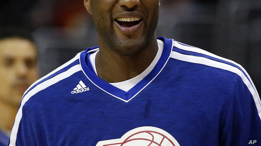 Los Angeles Clippers' Lamar Odom smiles during an NBA basketball practice in Los Angeles, March 13, 2013.