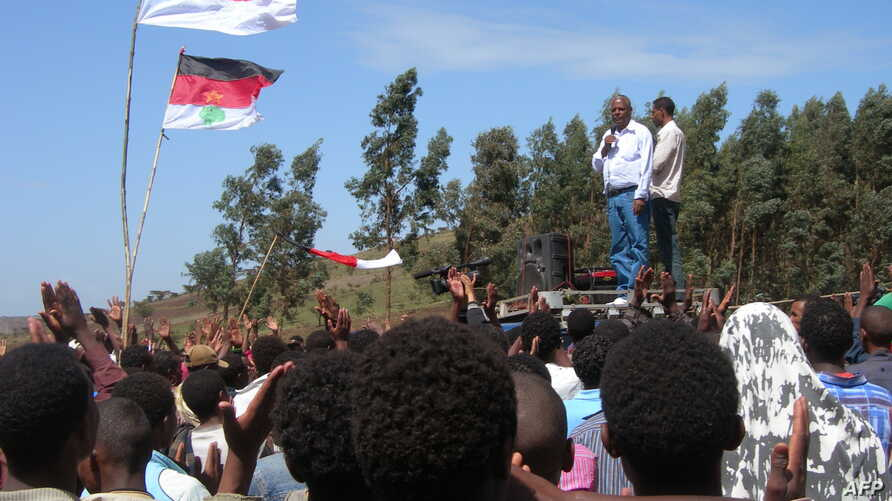 FILE - Merara Gudina, top left, the chairman of the Oromo people's Congress addresses a crowd of supporters during a political rally in in his home town of Tokkee, May 15, 2010.