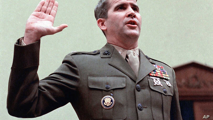 FILE - In this Dec. 18, 1986 file photo, Oliver North is sworn in on Capitol Hill in Washington prior to testifying before the House Foreign Affairs  Committee. In the never-ending quest to preserve the government's history, there have been plenty of...
