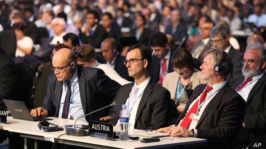 Delegates attend the opening ceremony of the Climate Change Conference in Lima, Peru, Dec. 1, 2014.