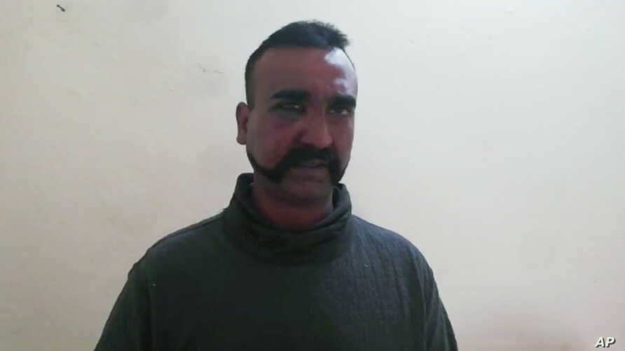 An image taken from video released by Pakistan's military, shows what Pakistan claims to be an Indian pilot who was captured after his plane was shot down by Pakistan's Air Force in the Pakistani-controlled part of Kashmir.
