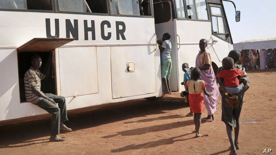 FILE - Newly arrived Sudanese refugees board buses to be taken to other camps in the area, in Yida, South Sudan, Feb. 20, 2018.