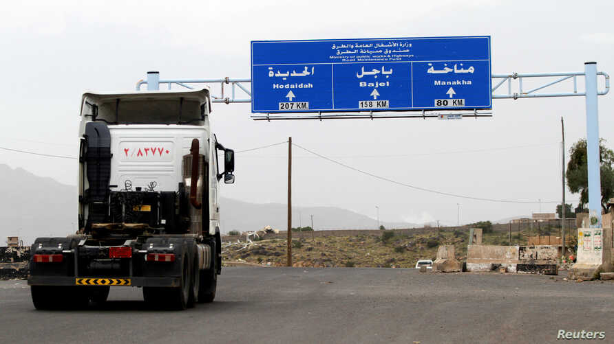 A truck drives on the main road linking Hodeidah with Sanaa, Yemen, Sept.13, 2018.