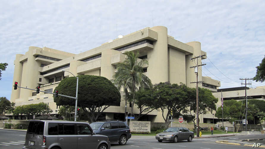 FILE - The federal building housing U.S. District Court in Honolulu, March 7, 2014. U.S. District Judge Derrick Watson halted President Donald Trump's revised travel ban Wednesday, hours before it was due to take effect.