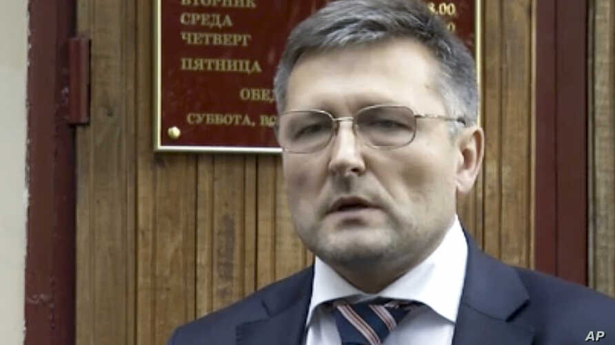 In this frame grab made from Sept. 13, 2012 AP video, lawyer Nikolai Govorkov leaves a court in Moscow.