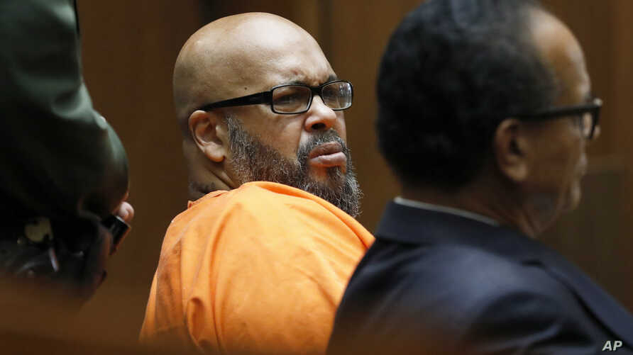 "Former rap mogul Marion ""Suge"" Knight, left, with his defense attorney Albert DeBlanc Jr., listens to the terms of his plea of no contest to voluntary manslaughter in Los Angeles Superior Court, Sept. 20, 2018."