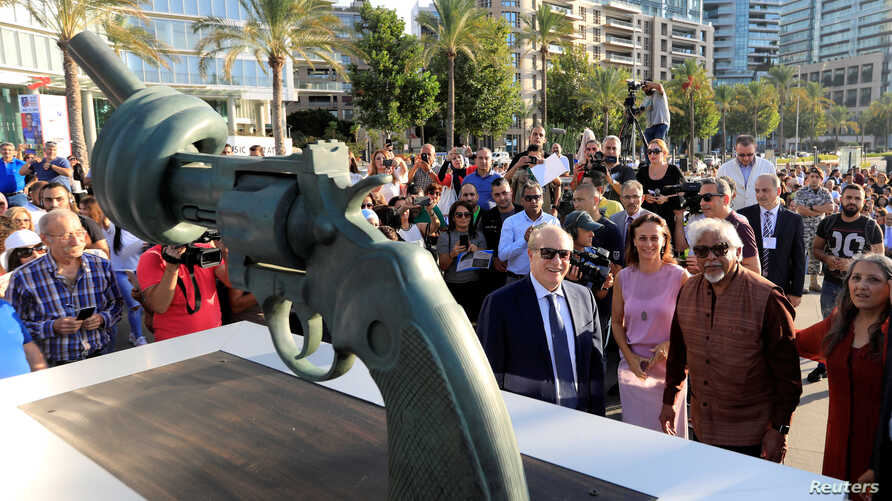 "Lebanon's Caretaker Cultural Minister Ghattas Khoury and Arun Gandhi, grandson of Mahatma Gandhi, are seen during the unveiling ceremony of a copy of Carl Fredrik Reutersward's ""Non-Violence"" sculpture in Beirut, Lebanon, Oct. 2, 2018."