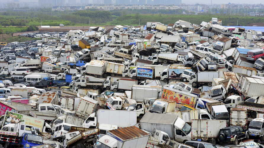 Scrapped high-emission vehicles are seen piled up at a dump site of a recycling centre, waiting to be dismantled, in Yiwu, Zhejiang province April 8, 2015. According to local media, the city of Yiwu is planning to get rid of approximately 22,000 high