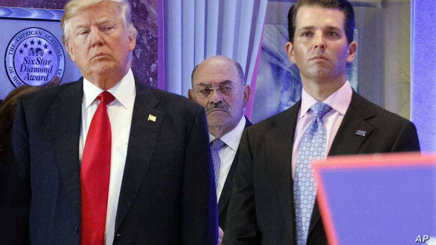 FILE -Allen Weisselberg (C) is seen between President-elect Donald Trump, left, and Donald Trump Jr., at a news conference in the lobby of Trump Tower in New York, Jan. 11, 2017.