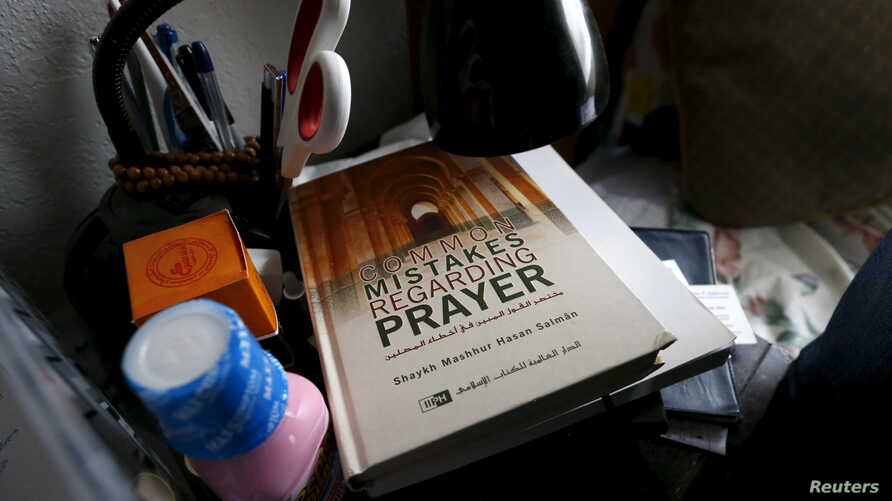 A book is shown inside the home of suspects Syed Rizwan Farook and Tashfeen Malik in Redlands, Calif., Dec. 4, 2015, following Wednesday's attacks in San Bernardino..
