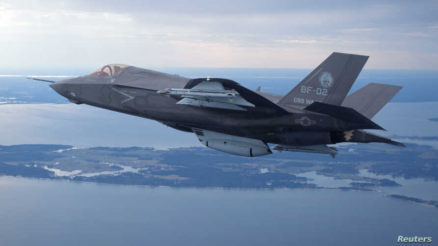 The U.S. Marine Corps version of Lockheed Martin's F-35 Joint Strike Fighter flies over the Atlantic test range at Patuxent River Naval Air Systems Command in Maryland in a Feb. 22, 2012 photo.