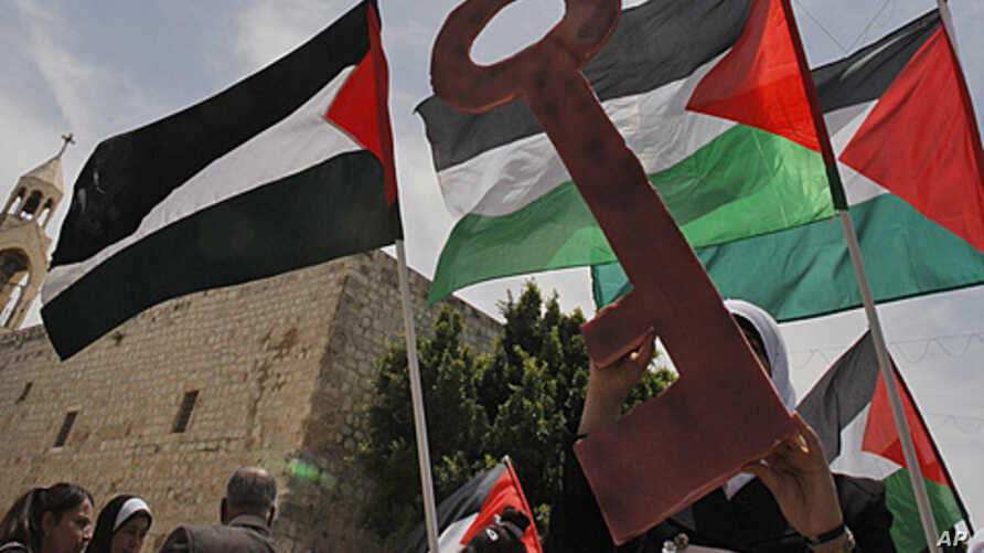 """Palestinians take part in a demonstration to mark the 63rd anniversary of """"Naqba,"""" in Manger Square outside the Church of Nativity in the West Bank city of Bethlehem, May 12, 2011"""