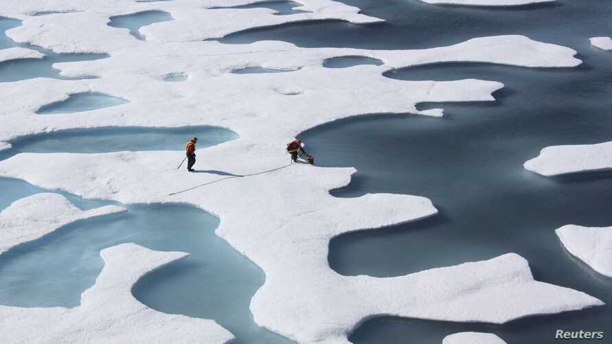 FILE -- The crew of the U.S. Coast Guard Cutter Healy, during its ICESCAPE mission, retrieves supplies in the Arctic Ocean, July 12, 2011.