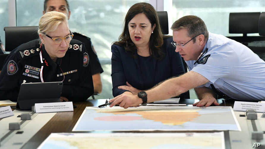 Queensland Fire and Emergency Services Commissioner, Katarina Carroll, from left, Queensland Premier Annastacia Palaszczuk and Queensland Police Deputy Commissioner Bob Gee discuss the approaching cyclone at the Emergency Services Complex in Brisbane
