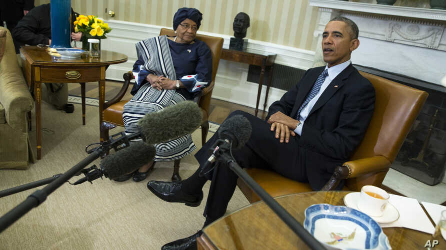 President Barack Obama meets with Liberian President Ellen Johnson Sirleaf to discuss the ongoing response to the Ebola outbreak in Western Africa and Liberia's recovery from the deadly virus, in the White House Oval Office in Washington, Feb. 27, 20