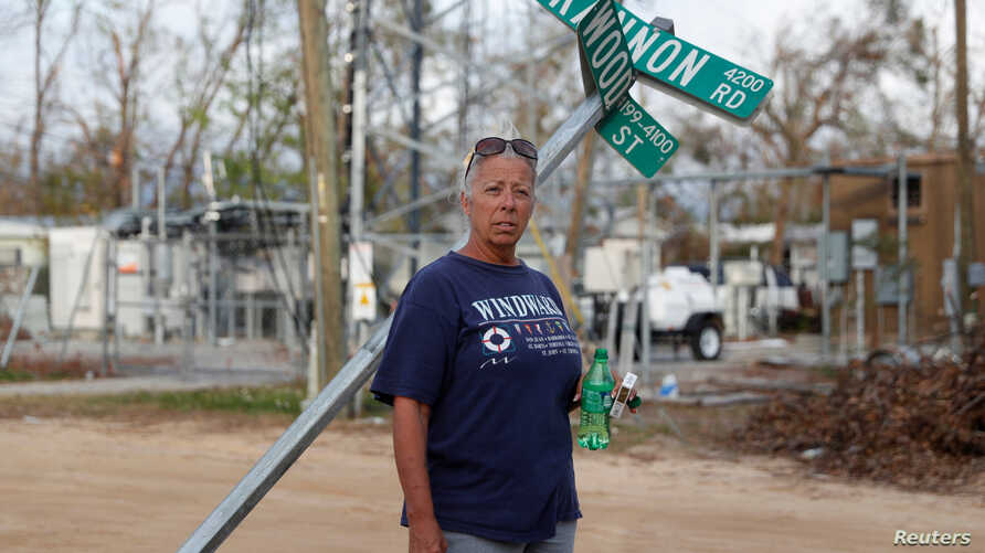 Sissy Karr, 55, poses for a portrait amid damage from Hurricane Michael in Panama City, Florida, Nov. 5, 2018.