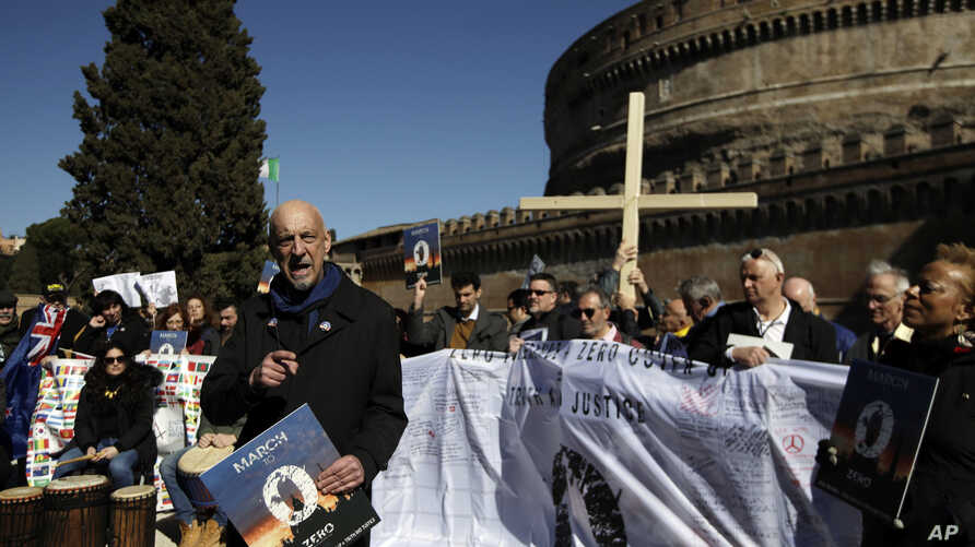 Sex abuse survivor Peter Isley, of the Ending Clergy Abuse organization, delivers his speech at the end of a demonstration in downtown Rome, Feb. 23, 2019.