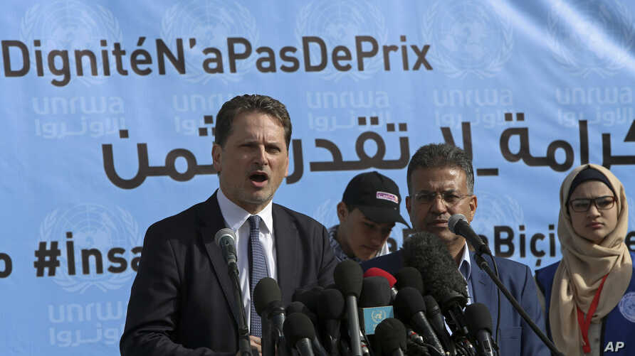 FILE - UNRWA's commissioner-general, Pierre Kraehenbuehl, left, gives a press conference to launch a global campaign to support UNRWA, at the UNRWA Rimal Girls Preparatory School in Gaza City, Jan. 22, 2018.
