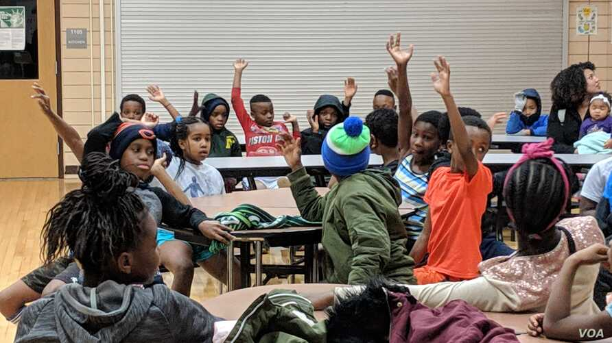 Thirty youngsters are eager to share with the group at Genesis Youth Foundation's nightly gathering in Des Moines, Iowa, Jan. 28, 2019.