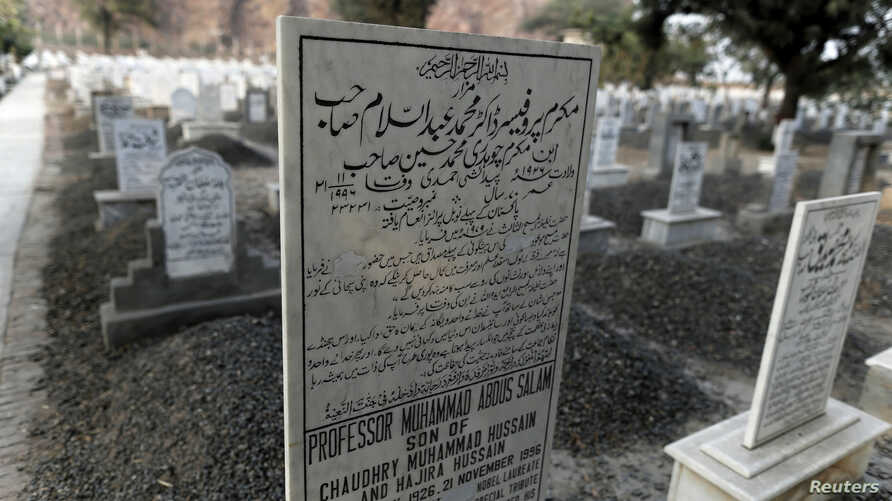 """The word """"Muslim"""" has been painted over by vigilantes, on the tombstone of Pakistani scientist Abdus Salam, a member of the Ahmadi community and Pakistan's only Nobel laureate, in the Ahmadi graveyard in the town of Rabwa, Dec. 9, 2013. A recent assa"""