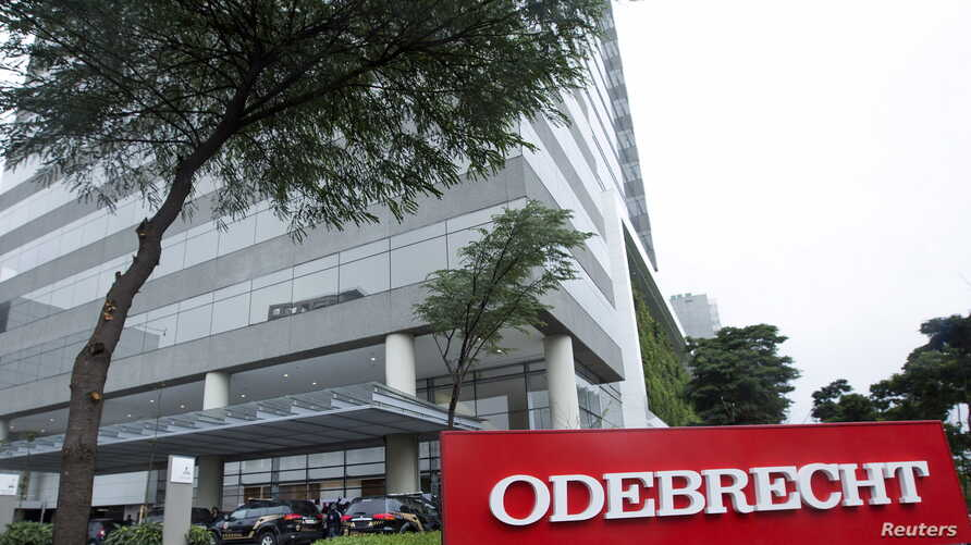 Federal police cars are parked in front of the headquarters of Odebrecht, a large private Brazilian construction firm, in Sao Paulo, Brazil, June 19, 2015.