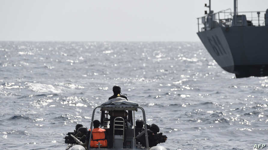 FILE - Nigerian special forces sail to intercept pirates during a joint exercise between Nigerian and Moroccan naval personels as part of Obangame Express, a multinational maritime exercise involving 33 countries off the coast of Lagos, March 20, 201
