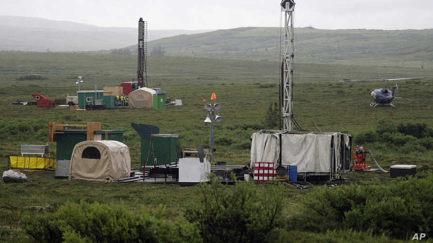 FILE - Workers with the Pebble Mine project test drill in the Bristol Bay region of Alaska near the village of Iliamma, July 13, 2007.