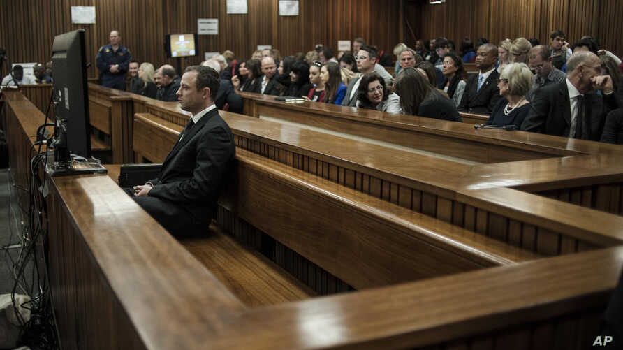 Oscar Pistorius, front left, listens to evidence in court in Pretoria, South Africa, June 30, 2014.