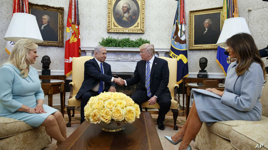 President Donald Trump and first lady Melania Trump meet with Israeli Prime Minister Benjamin Netanyahu and his wife Sara Netanyahu in the Oval Office of the White House, March 5, 2018, in Washington.